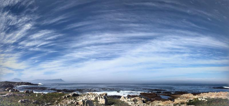 Figure 1: Panoramic view from a winter run in Betty's Bay. I was hoping Google Photos would stitch the pretty clouds together, and it did.